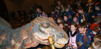 Scouts and company meet baby T-Rex on Monday at the Hotel Roanoke.
